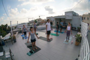 Yoga group session on the rooftop at sunset
