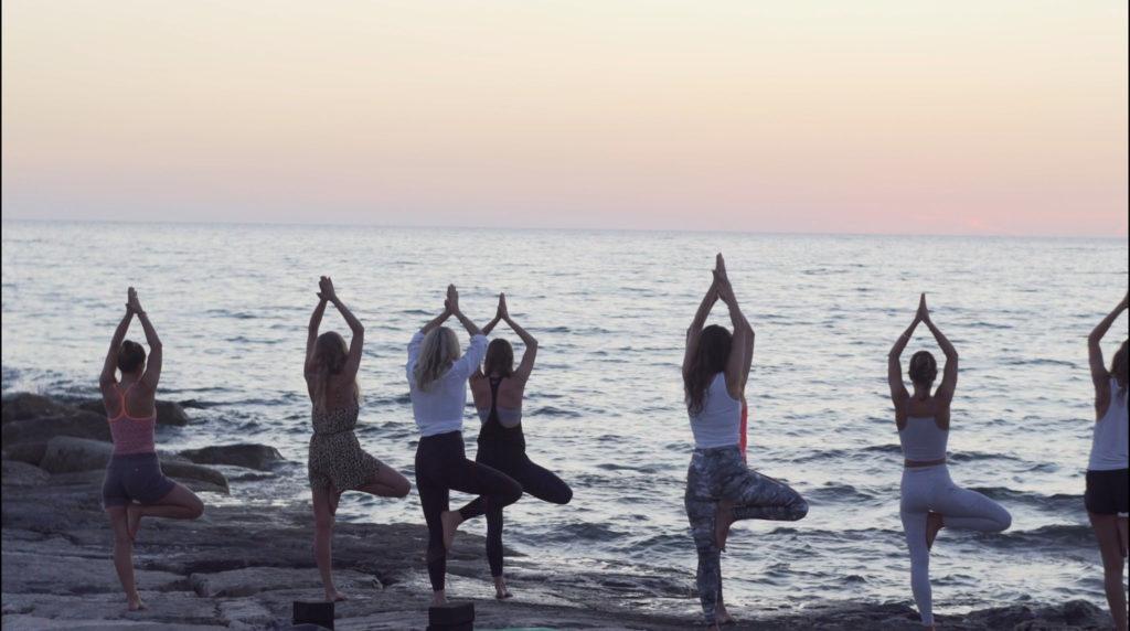 Yoga class organised on the beach